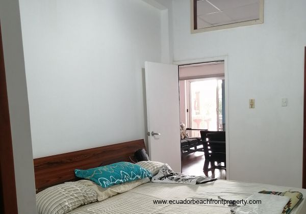 Master bedroom leads out to the social living area.