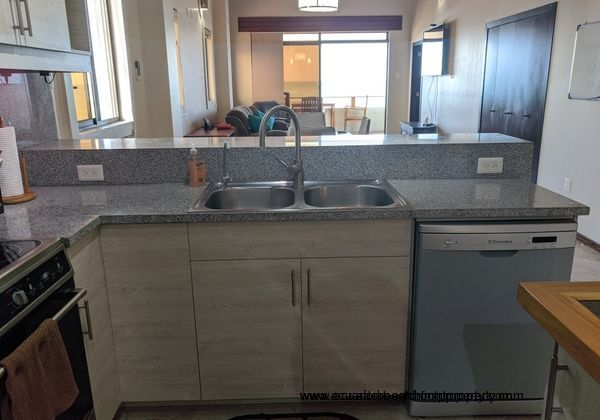 Double sink and dishwasher.