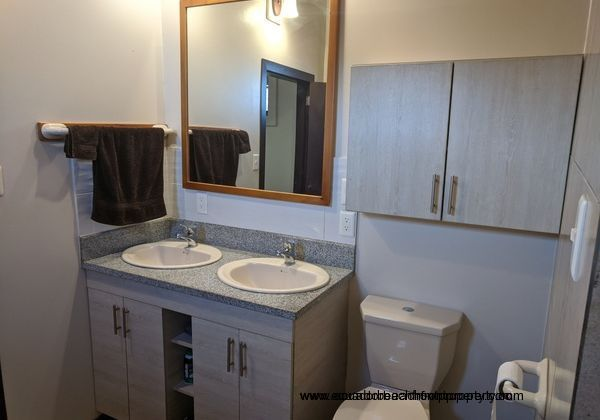 Second master bath with twin sinks.