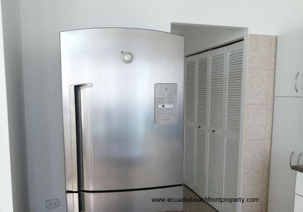 Comes with large fridge freezer.