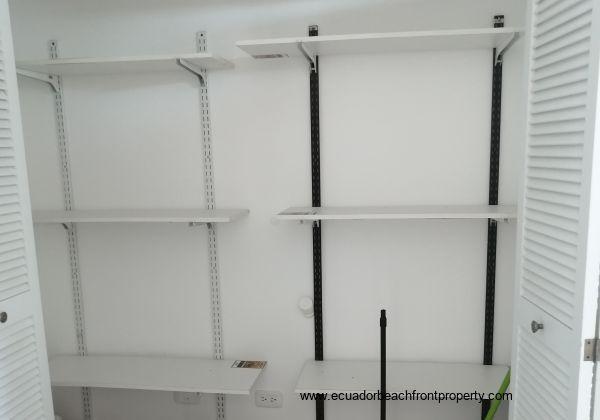 Storage area, fully shelved.