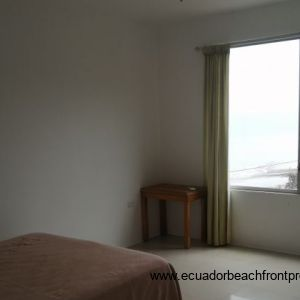 Second bedroom with a double bed and built in wardrobe and AC.