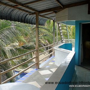 Covered oceanview balcony on the 2nd level with 3 guest rooms